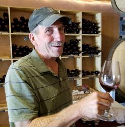 Steve Baker smiles, glass in hand.