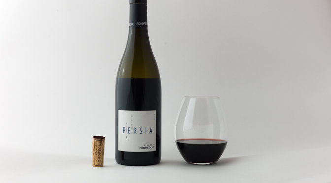 A cork, a wine bottle, and a glass of wine on white background.