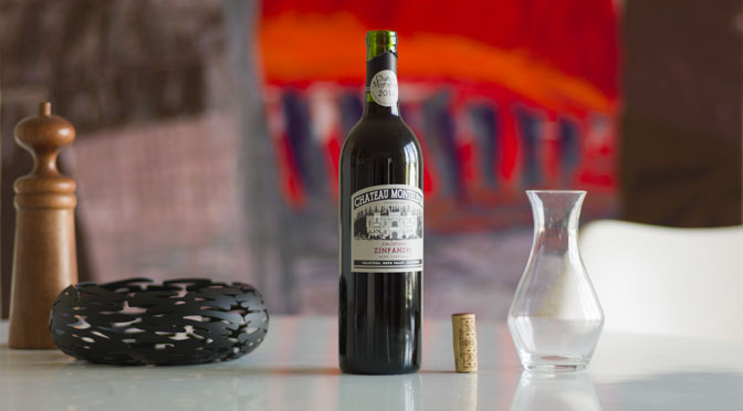 A bottle of Chateau Montelena Zinfandel 2014 on a table with cork and carafe